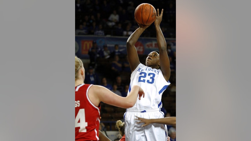 Kentucky's Samarie Walker (23) shoots near Bradley's Kelly Frings during the first half of an NCAA college basketball game, Wednesday, Nov. 27, 2013, in Lexington, Ky. (AP Photo/James Crisp)