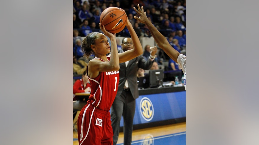 Bradley's Michelle Young (1) shoots over the out stretched arm of Kentucky's Janee Thompson during the second half of an NCAA college basketball game, Wednesday, Nov. 27, 2013, in Lexington, Ky. (AP Photo/James Crisp)
