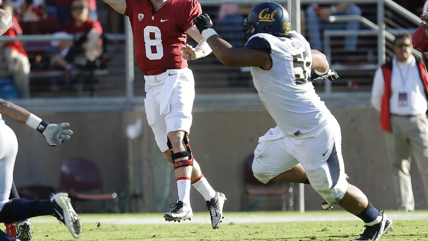 Stanford quarterback Kevin Hogan (8) throws under pressure from California defensive lineman Viliami Moala (55) during the first half of an NCAA college football game in Stanford, Calif., Saturday, Nov. 23, 2013. (AP Photo/Tony Avelar)