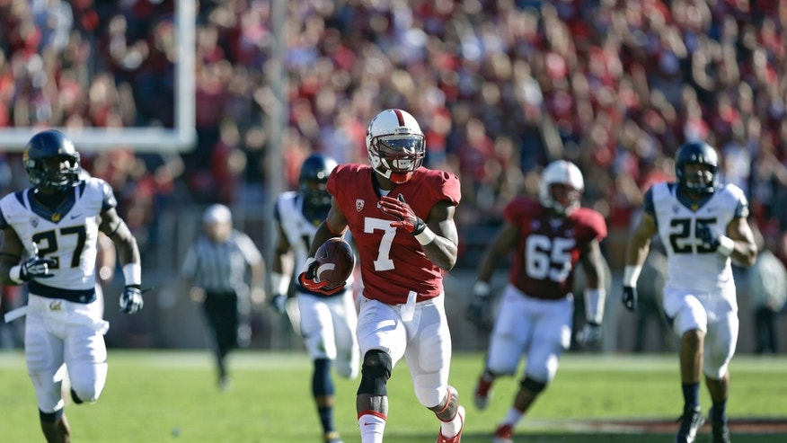 Stanford wide receiver Ty Montgomery (7) runs for a touchdown against California defenders during the first half of an NCAA college football game in Stanford, Calif., Saturday, Nov. 23, 2013. (AP Photo/Tony Avelar)