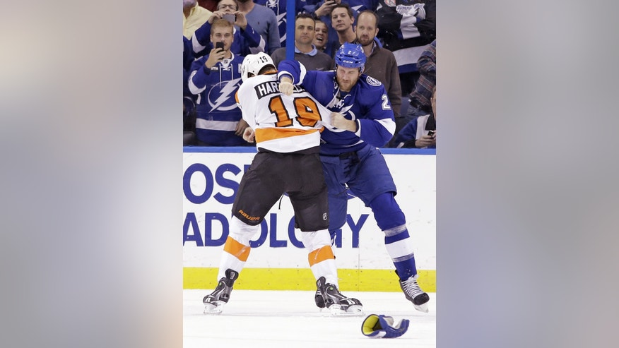 Tampa Bay Lightning defenseman Eric Brewer (2) fights with Philadelphia Flyers left wing Scott Hartnell (19) during the second period of an NHL hockey game Wednesday, Nov. 27, 2013, in Tampa, Fla. Both players received five-minute major penalties. (AP Photo/Chris O'Meara)