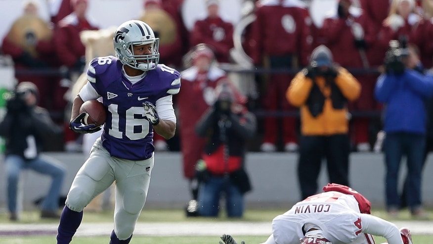 Kansas State wide receiver Tyler Lockett (16) gets past Oklahoma defensive back Aaron Colvin (14) to run for a first down during the first half of an NCAA college football game Saturday, Nov. 23, 2013 in Manhattan, Kan. (AP Photo/Charlie Riedel)