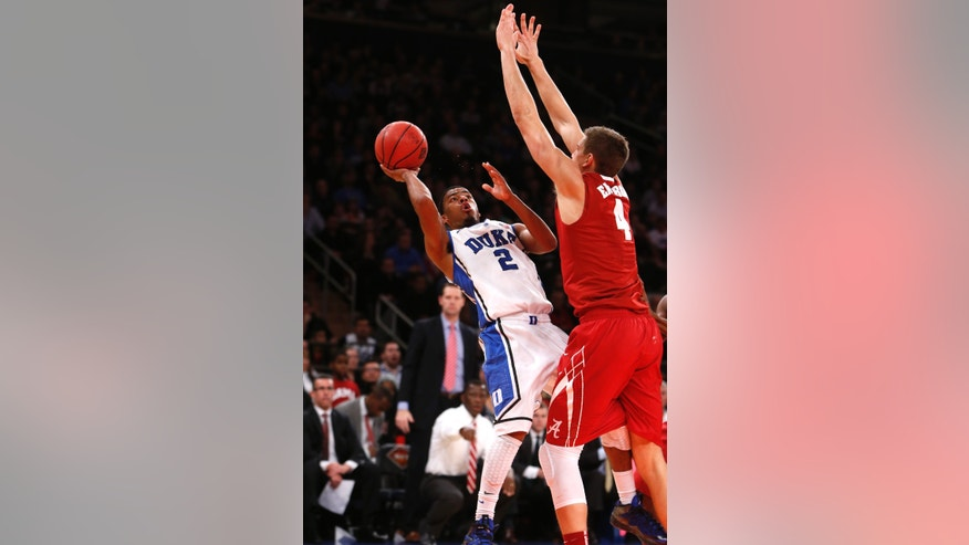 Duke's Quinn Cook (2) shoots against Alabama's Carl Engstrom (4) during the first half of an NCAA college basketball game in the semifinals of the NIT Season Tip-off tournament Wednesday, Nov. 27, 2013, in New York. (AP Photo/Jason DeCrow)