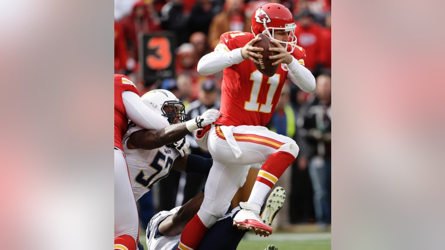 Kansas City Chiefs quarterback Alex Smith (11) is sacked by San Diego Chargers linebacker Jonas Mouton (57) during the first half of an NFL football game at Arrowhead Stadium in Kansas City, Mo., Sunday, Nov. 24, 2013. (AP Photo/Charlie Riedel)