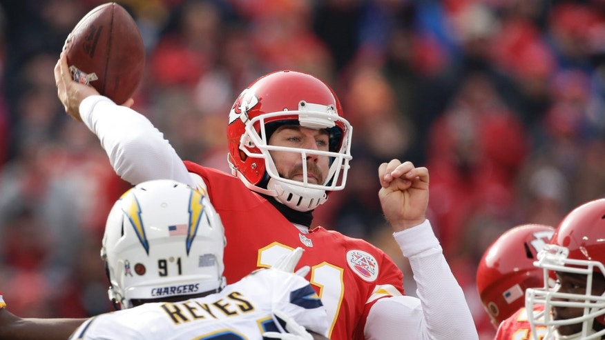 Kansas City Chiefs quarterback Alex Smith (11) passes under pressure from San Diego Chargers defensive end Kendall Reyes (91) during the first half of an NFL football game at Arrowhead Stadium in Kansas City, Mo., Sunday, Nov. 24, 2013. (AP Photo/Charlie Riedel)
