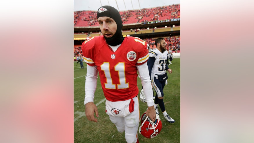 Kansas City Chiefs quarterback Alex Smith (11) walks off the field after the Chiefs lost to the San Diego Chargers in an NFL football game on Sunday, Nov. 24, 2013, in Kansas City, Mo. The Chargers won the game 41-38. (AP Photo/Charlie Riedel)