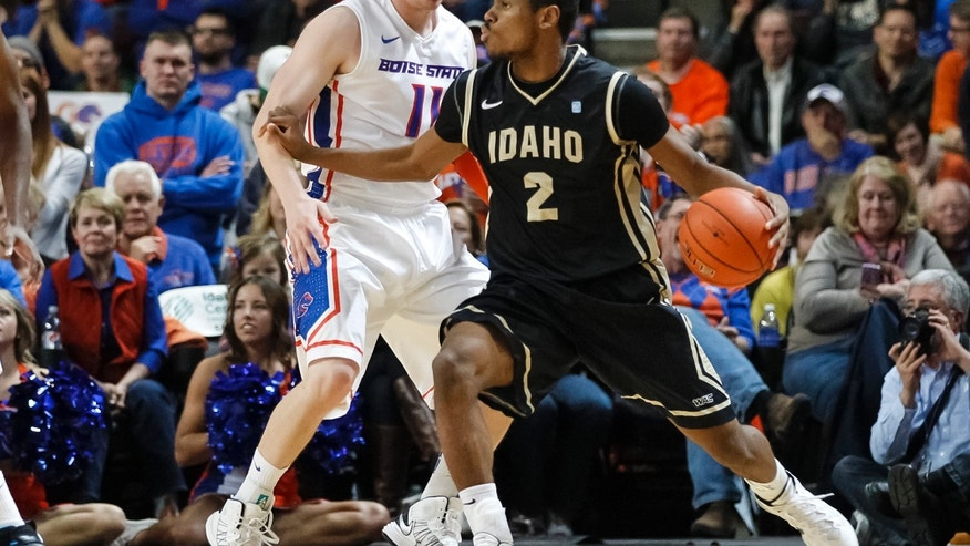 Idaho's Sekou Wiggs (2) defends as Boise State's Jeff Elorriaga (11) dribbles during the first half of an NCAA college basketball game in Boise, Idaho, Wednesday, Nov. 27, 2013. (AP Photo/Otto Kitsinger)
