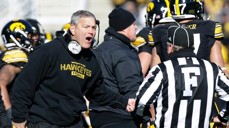 Iowa head coach Kirk Ferentz reacts to a call against his team during the first half of an NCAA college football game against Michigan, Saturday, Nov. 23, 2013, in Iowa City, Iowa. (AP Photo/Charlie Neibergall)