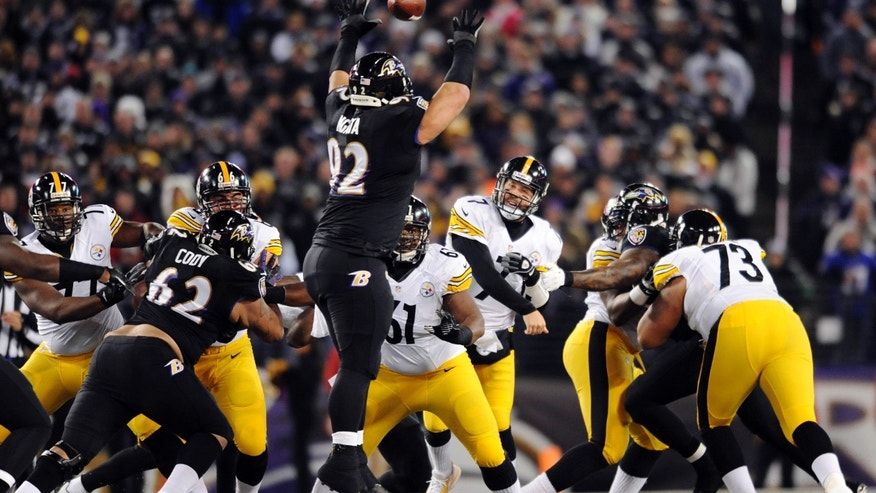 Baltimore Ravens nose tackle Haloti Ngata (92) tries but cannot block a pass by Pittsburgh Steelers quarterback Ben Roethlisberger (7) in the first half of an NFL football game Thursday, Nov. 28, 2013, in Baltimore. (AP Photo/Gail Burton)