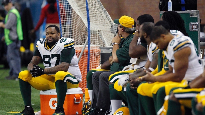 Green Bay Packers defensive end Johnny Jolly (97) and teammates sit during the closing minutes of an NFL football game against the Detroit Lions in Detroit, Thursday, Nov. 28, 2013. (AP Photo/Duane Burleson)