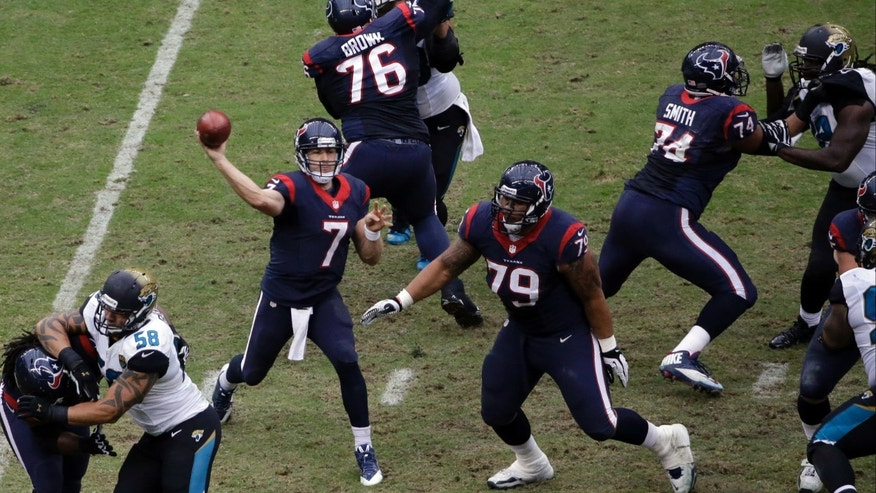 Houston Texans quarterback Case Keenum (7) passes against the Jacksonville Jaguars during the third quarter of an NFL football game Sunday, Nov. 24, 2013, in Houston. (AP Photo/David J. Phillip)