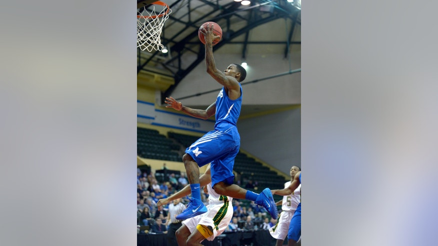 Memphis guard Joe Jackson goes up for a layup during the first half of an NCAA college basketball game against Siena in Kissimmee, Fla., Thursday, Nov. 28, 2013. (AP Photo/Phelan M. Ebenhack)