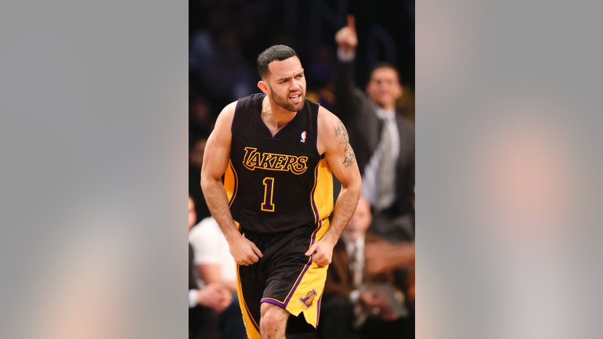 Los Angeles Lakers point guard Jordan Farmar (1) reacts after scoring three points on a stolen ball in the second quarter of an NBA basketball game against the Brooklyn Nets at the Barclays Center, Wednesday, Nov. 27, 2013, in New York. (AP Photo/John Minchillo)