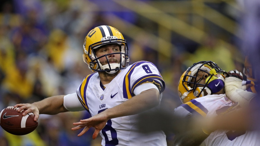 LSU quarterback Zach Mettenberger (8) passes in the first half of an NCAA college football game against Texas A&M in Baton Rouge, La., Saturday, Nov. 23, 2013. (AP Photo/Gerald Herbert)