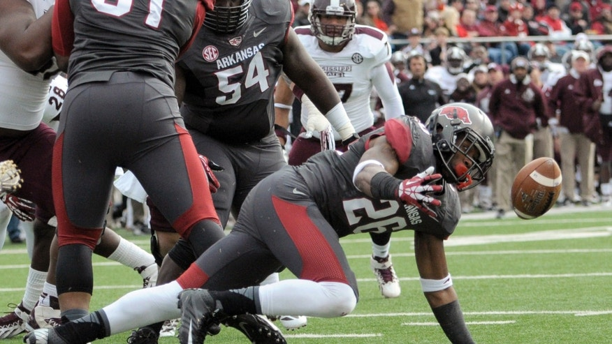 Arkansas safety Rohan Gaines recovers a Mississippi State fumble at the one-yard line in the second quarter of an NCAA college football game in Little Rock, Ark., Saturday, Nov. 23, 2013. (AP Photo/David Quinn)