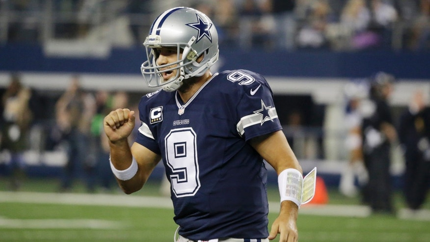 Dallas Cowboys quarterback Tony Romo (9) celebrates a touchdown against the Oakland Raiders during the second half of an NFL football game, Thursday, Nov. 28, 2013, in Arlington, Texas.  (AP Photo/LM Otero)