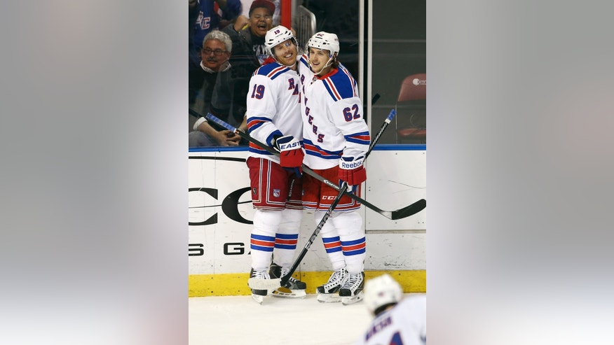 New York Rangers' Carl Hagelin (62) celebrates with Brad Richards (19) after Richards scored a goal against the Florida Panthers during the second period of a NHL hockey game in Sunrise, Fla., Wednesday, Nov. 27, 2013. (AP Photo/J Pat Carter)