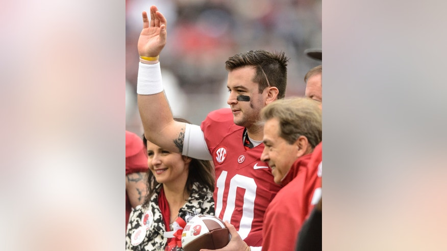 Alabama quarterback AJ McCarron (10) waves to the crowd with mother Dee Dee Bonner left, and Alabama head coach Nick Saban at right, during Alabama Senior Day celebration before an NCAA football game against Chattanooga, Saturday, Nov. 23, 2013, at Bryant-Denny Stadium in Tuscaloosa, Alabama. (AP Photo/AL.com, Vasha Hunt) MAGS OUT