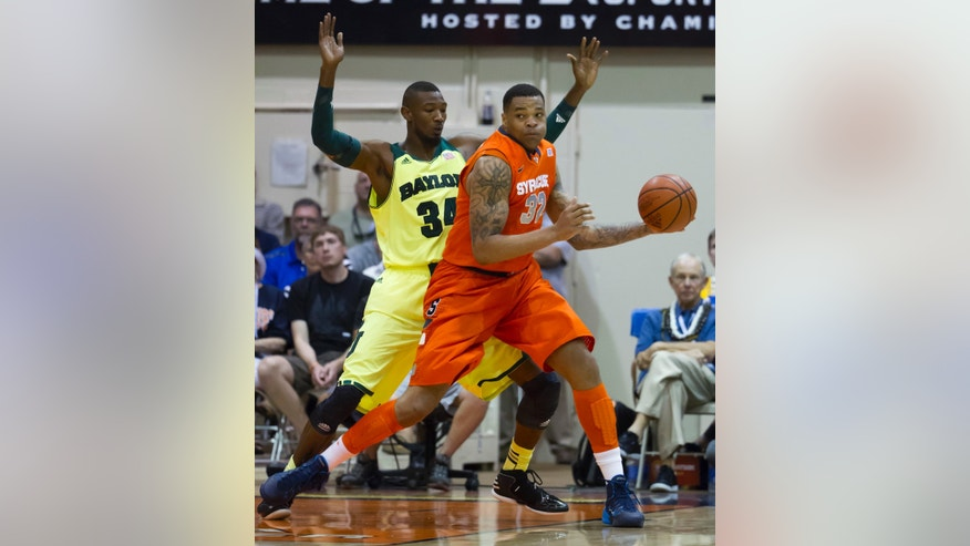 Baylor forward Cory Jefferson (34) guards Syracuse forward DaJuan Coleman (32) in the first half of an NCAA college basketball game at the Maui Invitational on Wednesday, Nov. 27, 2013, in Lahaina, Hawaii. (AP Photo/Eugene Tanner)