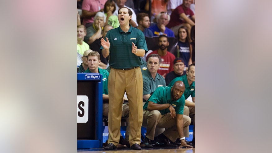 Baylor head coach Scott Drew shouts instructions to his team in the first half of an NCAA college basketball game at the Maui Invitational on Wednesday, Nov. 27, 2013, in Lahaina, Hawaii. (AP Photo/Eugene Tanner)
