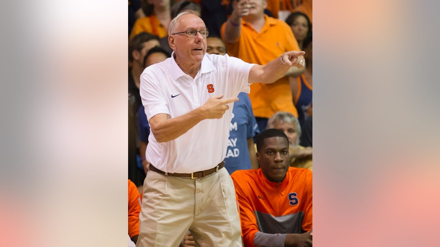 Syracuse head coach Jim Boeheim points of one of his players in the first half of an NCAA college basketball game at the Maui Invitational on Wednesday, Nov. 27, 2013, in Lahaina, Hawaii. (AP Photo/Eugene Tanner)