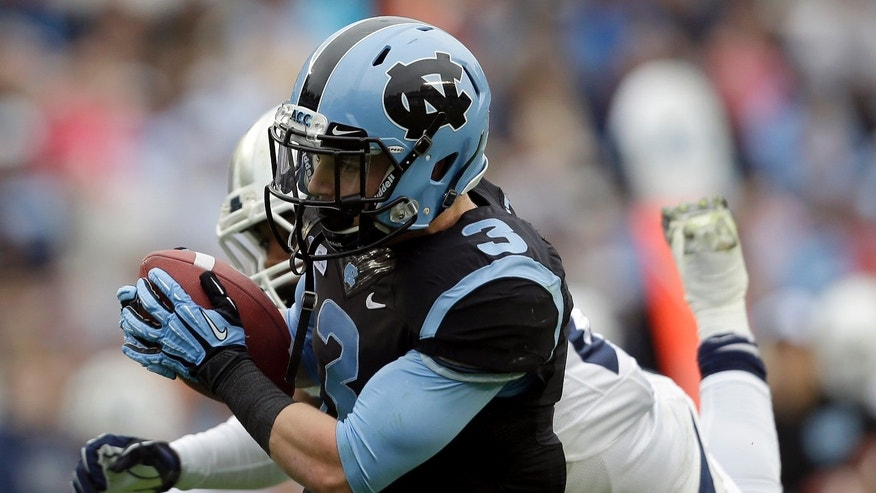 North Carolina's Ryan Switzer (3) catches a touchdown pass as Old Dominion's Fellonte Misher can't make the tackle during the first half of an NCAA college football game in Chapel Hill, N.C., Saturday, Nov. 23, 2013. (AP Photo/Gerry Broome)