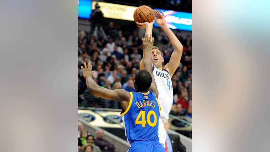 Dallas Mavericks power forward Dirk Nowitzki (41) shoots over Golden State Warriors small forward Harrison Barnes (40) in the first half during an NBA basketball game on Wednesday, Nov. 27, 2013, in Dallas. (AP Photo/Matt Strasen)