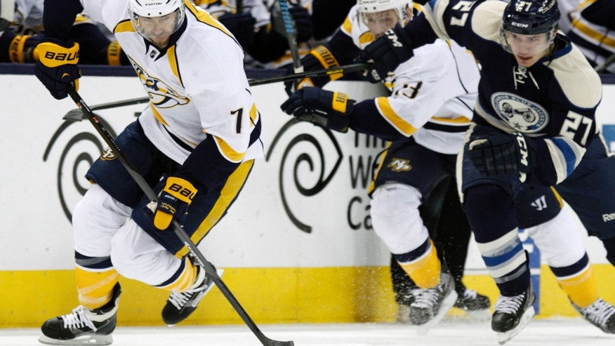 Nashville Predators' Matt Cullen, left, carries the puck in front of Columbus Blue Jackets' Ryan Murray in the first period of an NHL hockey game in Columbus, Ohio, Wednesday, Nov. 27, 2013. (AP Photo/Paul Vernon)