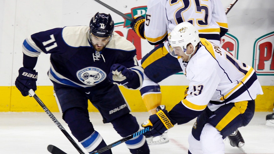 Nashville Predators' Nick Spaling, right, works for the puck against Columbus Blue Jackets' Nick Foligno in the third period of an NHL hockey game in Columbus, Ohio, Wednesday, Nov. 27, 2013. Nashville won 4-0. (AP Photo/Paul Vernon)