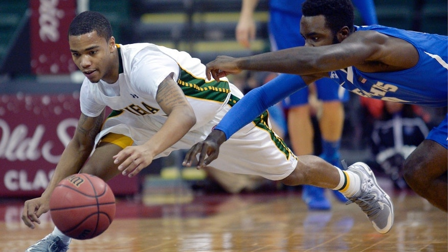 Siena guard Marquis Wright, left, and Memphis guard Damien Wilson dive after a loose ball during the first half of an NCAA college basketball game in Kissimmee, Fla., Thursday, Nov. 28, 2013. (AP Photo/Phelan M. Ebenhack)