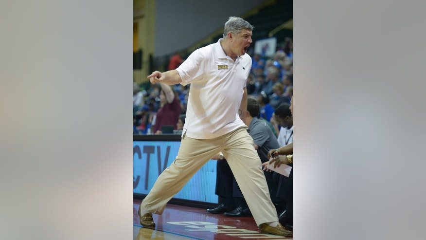 Siena head coach Jimmy Patsos reacts to a play during the first half of an NCAA college basketball game against Memphis in Kissimmee, Fla., Thursday, Nov. 28, 2013. (AP Photo/Phelan M. Ebenhack)