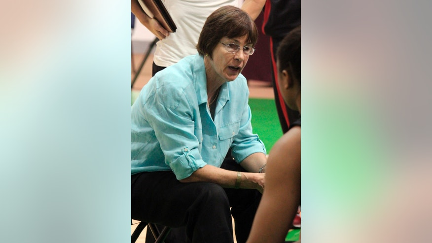 In this image provided by Plan BC3, Stanford coach Tara VanDerveer talks to her players during a timeout against Florida Gulf Coast in an NCAA college basketball game Wednesday, Nov. 27, 2013, in Puerto Vallarta, Mexico. VanDerveer became the fifth women's coach to reach 900 victories with No. 6 Stanford's 83-59 win Wednesday.  (AP Photo/Plan BC3, Casey Murphy)