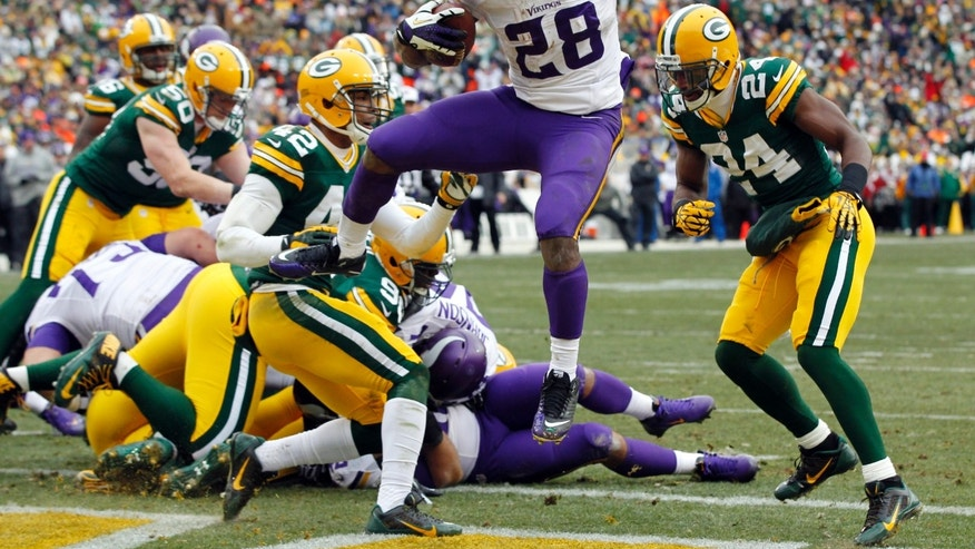 Minnesota Vikings' Adrian Peterson breaks into the end zone for a touchdown run during the first half of an NFL football game against the Green Bay Packers Sunday, Nov. 24, 2013, in Green Bay, Wis. (AP Photo/Mike Roemer)