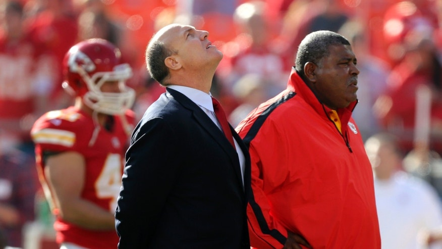 ADVANCE FOR WEEKEND EDITIONS, NOV. 30-DEC.  1 - FILE - In this Dec. 2, 2012, file photo, Kansas City Chiefs general manager Scott Pioli, left, and coach Romeo Crennel stand together before an NFL football game against the Carolina Panthers at Arrowhead Stadium in Kansas City, Mo. It was one year ago this weekend that linebacker Jovan Belcher shot to death the mother of his child, drove to the Arrowhead Stadium practice facility and turned the gun on himself. One of the darkest days in franchise history shook the Chiefs and the city they call home to their very core.  (AP Photo/Ed Zurga, File)