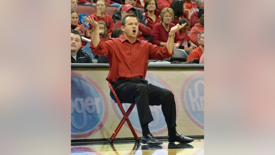 Louisville head coach Jeff Walz reacts to an official's call in front of the scorers' table during the second half of an NCAA college basketball game against Florida State, Sunday Nov. 24, 2013, in Louisville, Ky. Louisville defeated Florida State in overtime 69-59. (AP Photo/Timothy D. Easley)