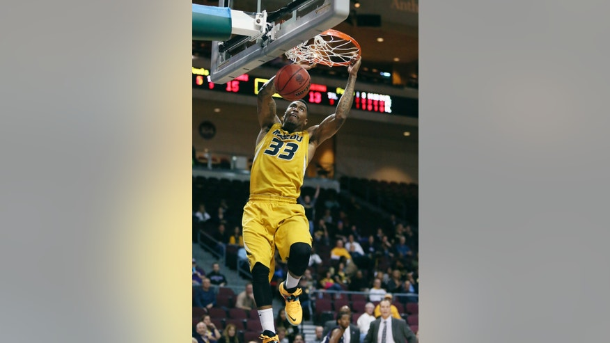 Missouri guard Earnest Ross dunks the ball in the first half of a game against Northwestern during the Las Vegas Invitational NCAA college basketball tournament Thursday, Nov. 28, 2013, in Las Vegas. (AP Photo/Ronda Churchill)