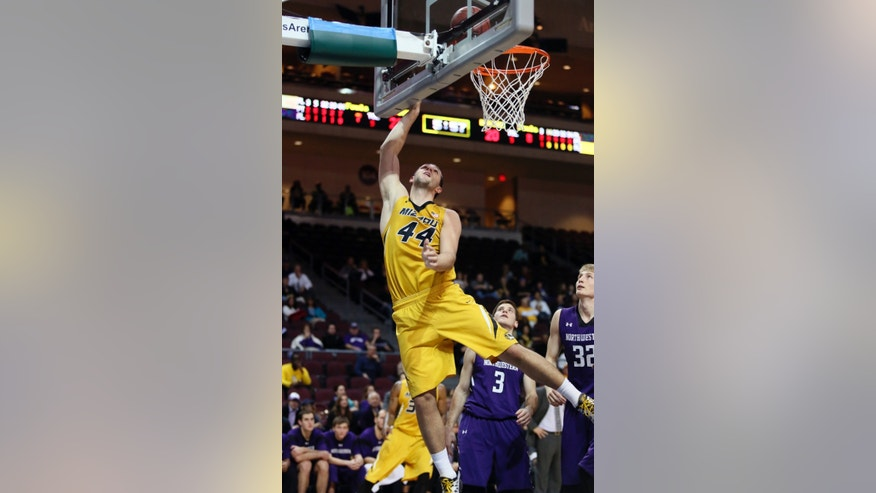 Missouri forward Ryan Rosburg makes a shot in the first half of a game against Northwestern during the Las Vegas Invitational NCAA college basketball tournament Thursday, Nov. 28, 2013, in Las Vegas. (AP Photo/Ronda Churchill