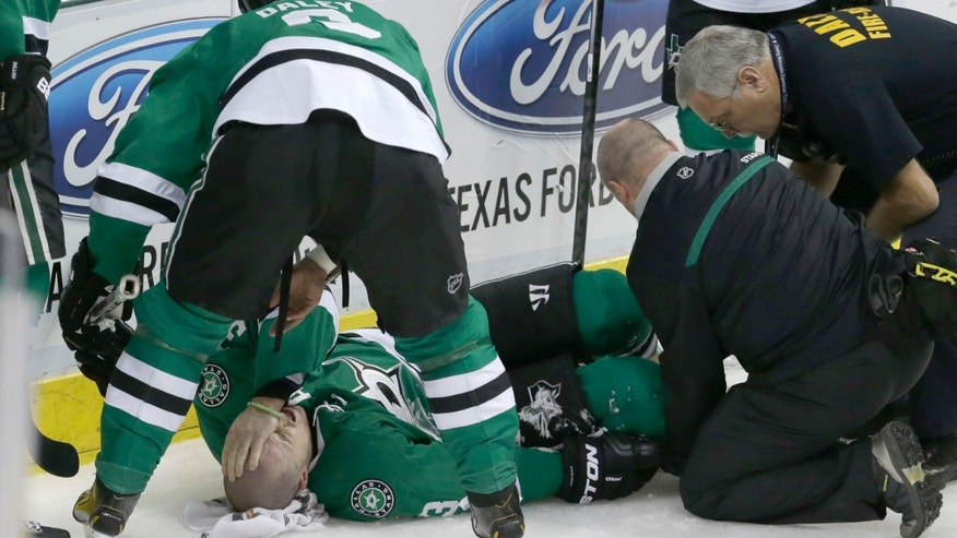 Dallas Stars defenseman Stephane Robidas lies on the ice after injuring his leg during the second period of an NHL hockey game against the Chicago Blackhawks on Friday, Nov. 29, 2013, in Dallas. (AP Photo/LM Otero)