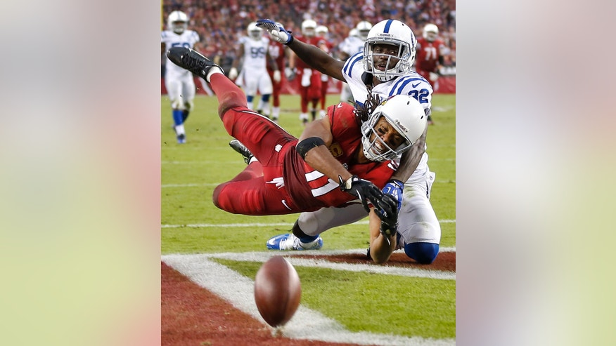 Arizona Cardinals wide receiver Larry Fitzgerald (11) can't make the catch as Indianapolis Colts cornerback Cassius Vaughn (32) defends during the second half of an NFL football game, Sunday, Nov. 24, 2013, in Glendale, Ariz. (AP Photo/Matt York)