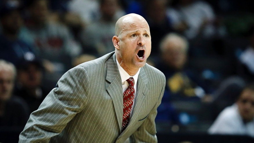 Mississippi head coach Andy Kennedy directs his players from the bench in the first half of an NCAA college basketball game against Georgia Tech during the Barclays Center Classic, Friday, Nov. 29, 2013, in New York. (AP Photo/John Minchillo)