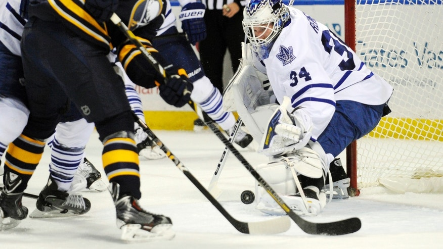 Buffalo Sabres' Zemgus Girensons (28), of Latvia, chases a rebound in front of Toronto Maple Leafs' James Reimer (34) during the first period of an NHL hockey game in Buffalo, N.Y., Friday, Nov. 29, 2013. (AP Photo/Gary Wiepert)