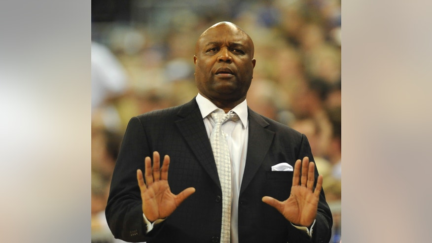Florida State coach Leonard Hamilton watches the play against Florida while signaling his team during the second half of an NCAA college basketball game on Friday, Nov. 29, 2013, in Gainesville, Fla. Florida won the game 67-66. (AP Photo/Phil Sandlin)