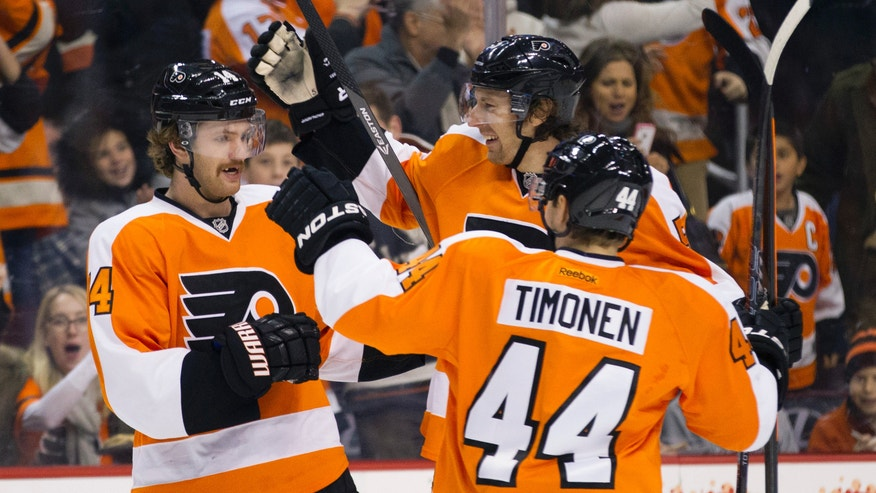 Philadelphia Flyers' Sean Couturier, left,  celebrates his goal with Braydon Coburn, center, and Kimmo Timonen, of Finland, right, during the second period of an NHL hockey game against the Winnipeg Jets, Friday, Nov. 29, 2013, in Philadelphia. (AP Photo/Chris Szagola)