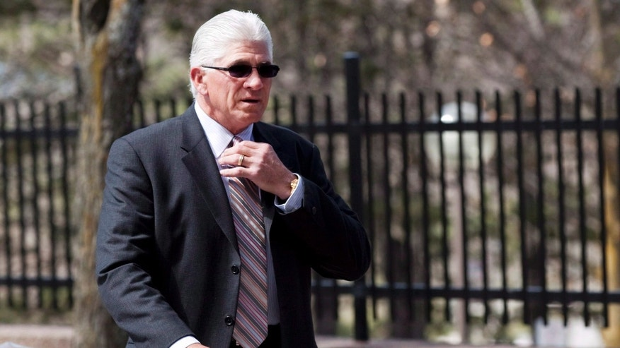 FILE -- IN an April 12, 2012 file photo former Toronto Maple Leafs captain Rick Vaive adjusts his tie as he enters a courthouse  in Newmarket, Ontario.  Ten former National Hockey League players, including former Toronto Maple Leafs' captain Vaive, claimed in a class-action lawsuit that the league hasn't done enough to protect players from concussions.  (AP Photo/The Canadian Press, Michelle Siu, file)