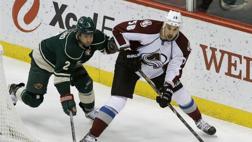 Colorado Avalanche left wing Patrick Bordeleau (58) controls the puck past Minnesota Wild defenseman Keith Ballard (2) during the first period of an NHL hockey game in St. Paul, Minn., Friday, Nov. 29, 2013. (AP Photo/Ann Heisenfelt)