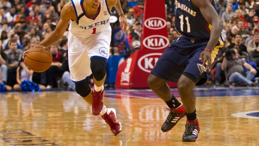 Philadelphia 76ers' Michael Carter-Williams, left, makes his move against New Orleans Pelicans' Jrue Holiday, right,  during the second quarter of an NBA basketball game Friday, Nov. 29, 2013, in Philadelphia. (AP Photo/Chris Szagola)