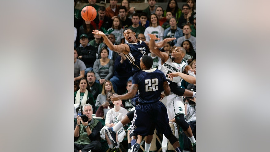 Mount St. Mary's Gregory Graves, left, reaches for a rebound against Michigan State's Adreian Payne and Mount St. Mary's Rashad Whack (22) during the first half of an NCAA college basketball game, Friday, Nov. 29, 2013, in East Lansing, Mich. (AP Photo/Al Goldis)