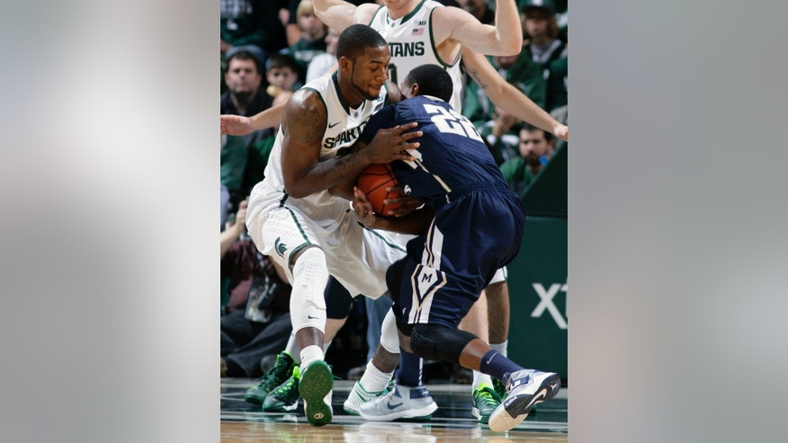 Michigan State's Branden Dawson, left, and Mount St. Mary's Rashad Whack wrestle for the ball during the first half of an NCAA college basketball game, Friday, Nov. 29, 2013, in East Lansing, Mich. (AP Photo/Al Goldis)