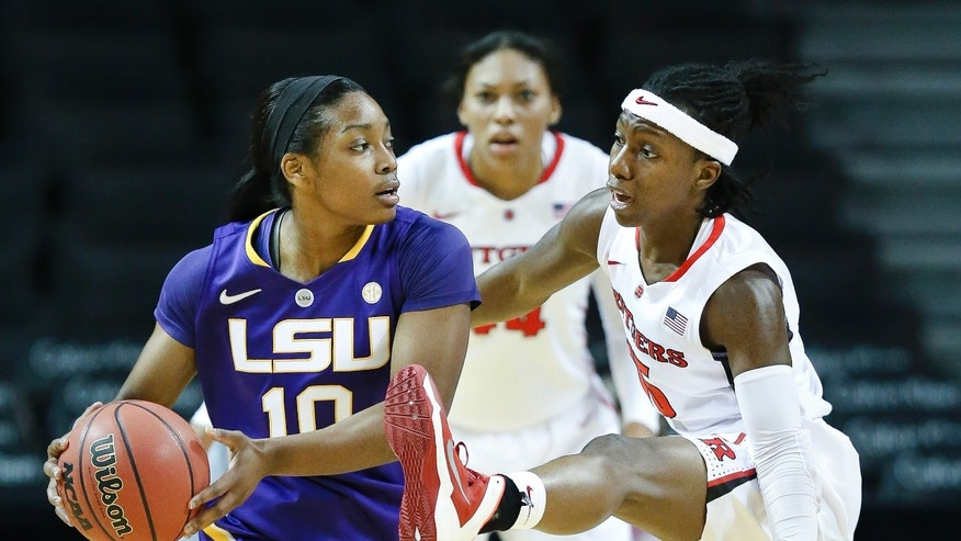 LSU guard Jasmine Rhodes (10) looks to pass around Rutgers guard Syessence Davis (15) in the first half of a NCAA college basketball game during the Barclays Center Women's Invitational at the Barclays Center, Friday, Nov. 29, 2013, in New York. (AP Photo/John Minchillo)