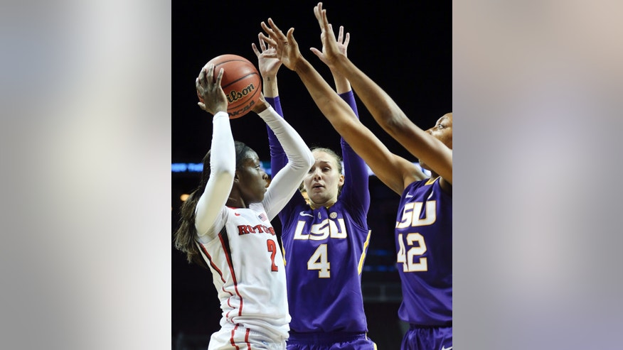 LSU guard Anne Pedersen (4) and forward Sheila Boykin (42) double-team Rutgers guard Kahleah Copper (2) in the first half of an NCAA college basketball game during the Barclays Center Women's Invitational, Friday, Nov. 29, 2013, in New York. (AP Photo/John Minchillo)